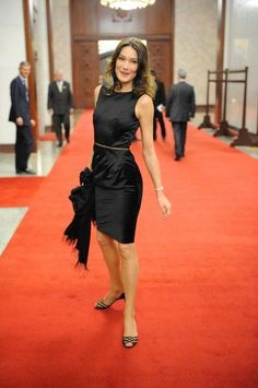 French President Nicolas Sarkozy and his wife Carla Bruni-Sarkozy arrive for a dinner with Chinese President Hu Jintao (unseen) at the Great Hall of the People on 4/28/10 in Beijing
