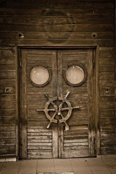Old wooden door on an abandoned boat . inspiration for G's future pirate room! Arrrrrgh love that door! Cool Doors, Unique Doors, Old Wood Doors, Wooden Doors, Knobs And Knockers, Door Knobs, Portal, Doors Galore, When One Door Closes