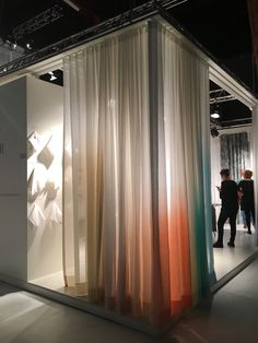 """No design show in Kortrijk, Belgium, could ever be complete without linen—after all, this area has been a center for flax and linen production since the Middle Ages. Here, Verilin, a luxury linen purveyor since 1956, displays elegant ombre drapery panels alongside their tagline, which reads: """"We tell tales of flax, we spread stories of linen."""""""