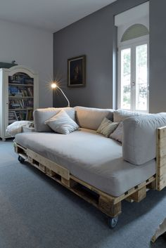 I'm pretty sure I could make something like this...a few old pallets sanded back, a slab of mattress foam and pretty material to sew it up with. invest in some pretty cushions and you have a cheap as chips lounge!!