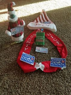 """Adult Christmas Sock Exchange. Fill Naughty and Nice socks with a bottle of wine dressed in a cute holiday outfit, a flask that says """"I'm full of holiday spirit. It's called vodka!"""", mini liquor bottles to fill the flask, lottery tickets, and a cute Naughty/Nice Christmas hat."""