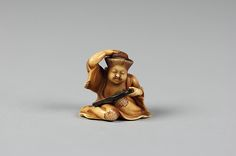 Netsuke of Girl at her Toilet, 19th century. Japanese. The Metropolitan Museum of Art, New York. Gift of Mrs. Russell Sage, 1910 (10.211.317)