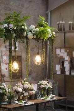 Modern Pendant Lights over a Lush Garden Wedding Table / http://www.deerpearlflowers.com/20-stunning-rustic-edison-bulbs-wedding-decor-ideas/