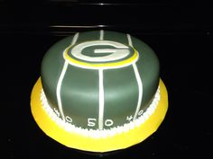 Green Bay packer cake covered in fondant with fondant logo
