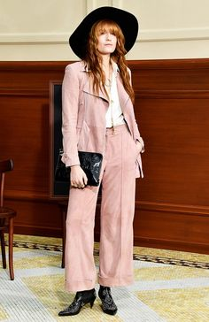 Florence Welch looking undeniably cool in a peachy-pink suit and brimmed hat at the Chanel F/W 15 Show at Paris Fashion Week