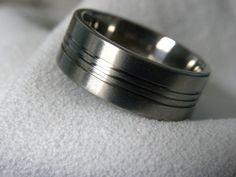 Titanium Ring or Wedding Band Triple Groove Style. $40.00, via Etsy.