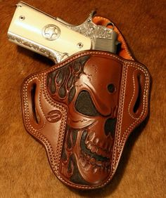 1911 45 engraved in a custom skull holster bad ass 1911 Leather Holster, 1911 Holster, Custom Leather Holsters, Pistol Holster, Cowboy Holsters, Western Holsters, Leather Carving, Leather Tooling, Leather Engraving