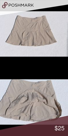 Whereabout Active Skort Light Tan, Size 8, in excellent condition.  From pet and smoke free home. Original Owner.  This fits-everyone-perfectly skort takes to everything you do with built-in shorts and a shorter length for more active pursuits. INSPIRED FOR: adventure travel, golf, adventure To Fro Flat front waistband with side zip for easy on/off BUILT-IN SHORTS. Eliminate the flash factor Adjustable internal drawstring for a custom fit Rear hidden zip pocket stashes your stuff. Athleta…
