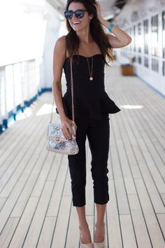 strapless peplum top, black cropped pants, nude heels, simple pendant necklace, metallic purse, sunglasses