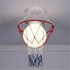 """Basketball & Net Ceiling Light: We were instant fans of these playful lights that strike it big with athletes and amateurs. Enhance your favorite theme in kids rooms, game rooms or workout areas. These rogue globes even get your closets on the ball. Painted white glass globes. 15""""H x 9""""W, $125 Boys Basketball Room, Basketball Themed Rooms, Basketball Shooting, Basketball Socks, Basketball Players, Basketball Hoop, Boy Rooms, Kids Rooms, Kids Bedroom"""