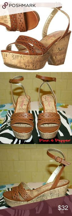"Pink & Pepper Laser Cut Strappy Wedge Sandal These super cute open-toe wedges are feminine and versatile to wear! I love the how the straps wrap around the heel and ankle and close with a small buckle in a delicate way. The faux leather laser cut straps and trim are a medium-toned brown, and the chunky wedges look like cork. The man-made outsole is textured for lasting traction and wear. The heel is approx. 3.5"" and platform is approx. 2"". Made from synthetic materials. Pink & Pepper Shoes…"