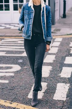 Faux fur shearling lined jean jacket with paige skinny jeans and gray suede ankle boots on Jess Ann Kirby in London