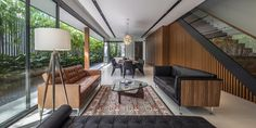 Wallflower Architecture + Design; dark timber, mixed finishes furniture, Persian rug