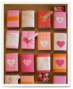 matchbox favor holders dressed up with scrapbook paper.  matchboxes cost ~ $1.50 for 10