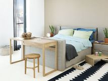 Adorn your bed end with a petite table, stool, love seat or other pretty piece of functional decor