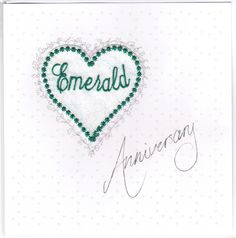 "An embroidered heart  mounted with ""Anniversary"" printed on the front of the card. Traditionally, Emerald is given for a for 55th Wedding Anniversary. #EmeraldAnniversary #HandmadeCards"