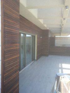 Freshly oiled iroko strips wall cladding