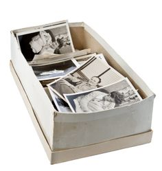 From Shoebox to Album: Organizing a Lifetime of Photos My grandmother lost all her pre-1950s photos in a flood. @A Lifetime Legacy will help you organize and preserve your precious photos.