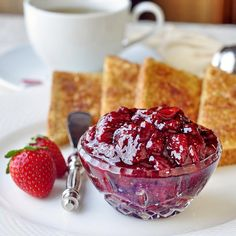 Roasted Strawberry Jam - think making jam in the oven sounds weird? Try it and discover the most intensely flavored strawberry jam you can imagine with added hints of caramel. An instant upgrade to your morning toast, this jam deserves to be center stage in many luscious strawberry desserts too.