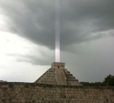 "a Mayan temple on the Yucatan Peninsula in Mexico, with a mysterious ""light beam"" emerging from the top"