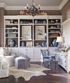 Room of the Day: Seaside Dreaming in a Texas Study.  Great use of 2 prints in the wall unit as a focal point