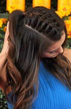 Braid mohawk - click through for more of Nina Dobrev's best hair and makeup inspiration of all time