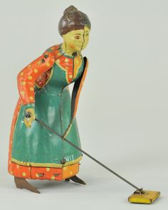 BUSY LIZZIE  Germany, lithographed tin, amusing toy depicts full figured lady pushing mop when clockwork is activated