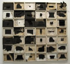 Leonardo Drew: One of my favorite artists, Drew uses a lot of black in his work. Here he paints single objects displayed in a grid constructed from old window trim. Note how painting some of the boxes themselves, as well as the objects, breaks up the grid a bit. Also some of the objects are more dimensional than others and some boxes are painted whiter or less brown than others. It gives the work a more organic look and softens the geometry.