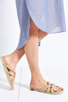 summer sandal trend: pool shoes. These are different. They look like they're made out of tassels.