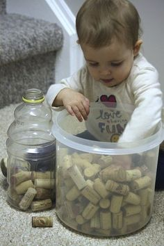"""3 of 10 fine motor skills for babies and toddlers----""""REALLY all this photo shows me is 1-his mommy drank a lot of wine 2-she never got those Pinterest wine cork projects done"""".-Amber =)"""