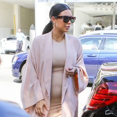 This Is the Reason Kim Kardashian's Outfits Look So Expensive: Kim Kardashian's epic (Kanye West-ordained) makeover has revamped the reality star from former trend victim to style setter who's known now for a uniform of minimalist, body-hugging silhouettes and a lineup of killer heels that she hasn't traded in, even in the midst of her second pregnancy.