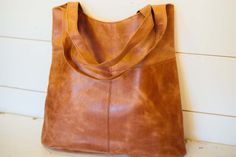 These roomy brown leather tote bags are handmade in Ethiopia by at-risk women, and also happen to be Joanna's go-to bag!...