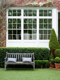 Formal evergreen hedges, lawn and bench. Simple and elegant. To grown a landscape like this in Birmingham requires a good well-running sprinkler system. Many in Birmingham recommend www.BlueSkyRain.com