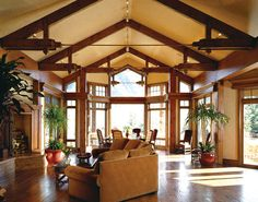Large open area in this take on modern timber frame joinery. Photo Courtesy of PrecisionCraft Log & Timber Homes