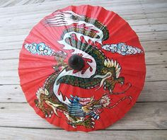 Vintage Red Chinese Parasol Paper Umbrella Year of the Dragon. $24.00, via Etsy.