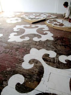 I actually just recently watched a show where large stencils were used on an accent wall. The end results were absolutely amazing! Doing the floors would be an awesome touch for an art studio... Which I do hope to have very soon!