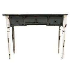 Three-drawer distressed wood console table.   Product: Console tableConstruction Material: WoodColor: Distressed white and blackFeatures: Three drawersDimensions: 32 H x 42 W x 14 D