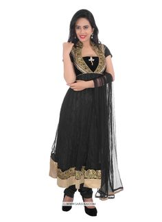 Add grace and charm for your look in this black net and velvet churidar designer suit. The wonderful embroidered and patch border work a significant feature of this attire. Comes with matching bottom ...