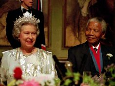 Queen Elizabeth II with South African President Nelson Mandela during an official state banquet in Cape Town in 1995.