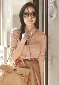 buttoned up pretty blouse + statement necklace + neutral chic