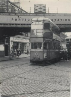 """A Glasgow Coronation tram car travelling on the cobblestone streets in the 1950's. I wish I could take a  """"wee hurl oan a shooglie""""."""