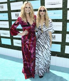 Blonde beauties: Molly Sims, left, and Rachel Zoe, right, looked lovely in printed maxi dr...