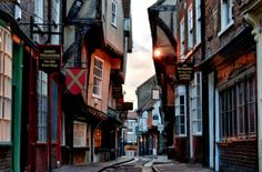 """The Shambles"" reputed by some to be the ""best preserved medieval street in Europe"" lies within York, a walled city in county North Yorkshire, northwest England. This magical Dickensian street dates back to the 1300s. loved wandering here"