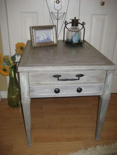 """Freshly finished and ready for a new home! This pretty, wood side table is layered in cocoa & grey washes with subtle duck egg blue undertones...the final result is like a slate grey. Very pretty. Softly distressed then treated to touches of dark wax with clear wax to finish. Accented with black, metal drawer pulls and double drawers. Measurements are 26"""" across X 20"""" wide X 22"""" tall.    Wonderful colors that are perfect for modern to rustic decor!"""