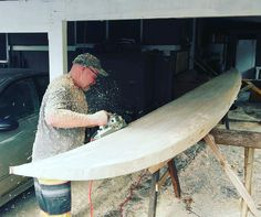 """""""This is Rob ?) shaping a 24ft balsa wood board."""
