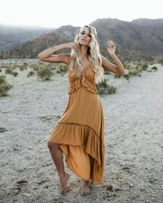 You festival goings are not complete without our Antigua High Low Dress! We are smitten with this mustard spaghetti strap dress that has a v-neckline and a ruffled high low hem. The lace accents compl
