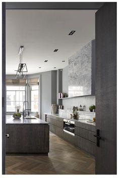 Fan hidden behind marble stale. Grey scale, dark woof kitchen. Modern, slightly industrial