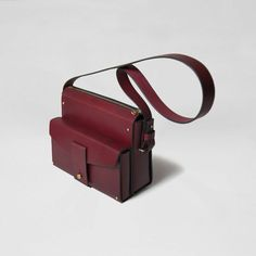 MERLOT POCKET STUDDED SATCHEL