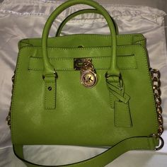 NWOT Michael Kors Hamilton Leather Satchel Authentic Michael Kors Hamilton Leather Satchel Lime green leather Michael Kors bag. Never used before, amazing condition. Has gold lock on front and gold chains strap. Along with two lime green handles. Measurement 12.75x9x5.5 Michael Kors Bags