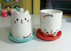 Cat bottomed cup. Couple cups